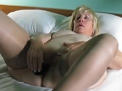 Aunt Sue strips with pubic hair